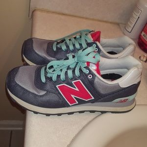 Grey blue and pink new balance shoes for women.